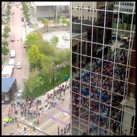The 10K start as seen from our hotel room window. Note all the oncoming runners reflected in the building in the right side of the photo.